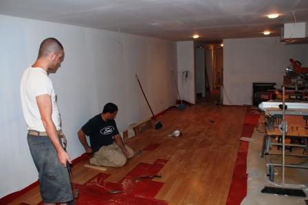 Installing wood floor & Basements by Victor Brubaker Builder